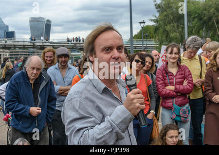 London, UK. 8th September 2018. A Green Party speaker at the Climate Reality rally in front of Tate Modern, one of thousands around the world demanding urgent action by government leaders to leaders commit to a fossil free world that works for all of us.  community leaders, organisers, scientists, storytellers and others Credit: Peter Marshall/Alamy Live News - Stock Image