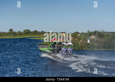 Airboat in motion on the Yale Canal Central Florida USA - Stock Image