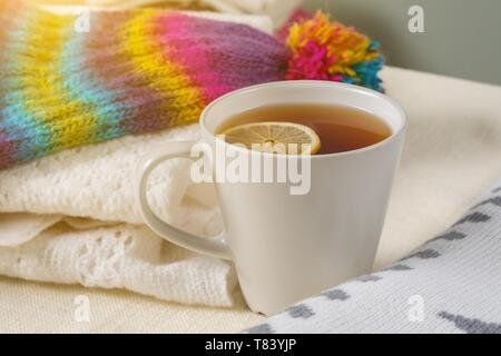 Cold winter - warm with warm clothes and hot drinks. - Stock Image