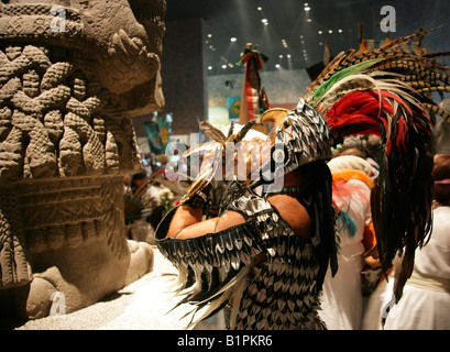 Shaman in Front of the Statue of Coatlicue at an Aztec Celebration in the National Museum of Anthropology, Mexico - Stock Image