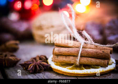 Christmas background with ornaments on an old wooden board. - Stock Image