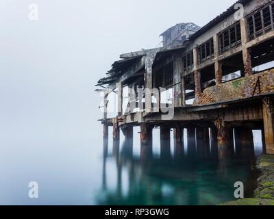 Derelict remains of torpedo launching platform in Rijeka Croatia - Stock Image