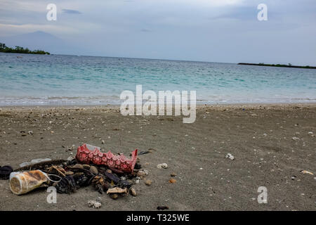 Plastic pollution washed up on a beach from the Atlantic ocean on the shores of the tropical island capital of Equatorial Guinea in west Africa - Stock Image