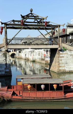 Tongli, China – November 28, 2008:. An unique wooden bridge at the entrance into Tongli Town's Pearl Pagoda scenic area in Jiangsu Province China - Stock Image