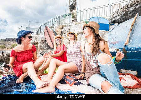People in friendship outdoor leisure activity - group of beautiful cheerful women friends enjoy together the day on vacation - trendy fashion lifestyl - Stock Image