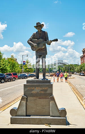 Memorial or commemorative statue of country western star Hank Williams, a tourist attraction, in downtown Montgomery Alabama, USA. - Stock Image