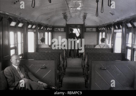 1950, historical, adult male passenger sitting inside a train carriage of this era, England, UK. - Stock Image