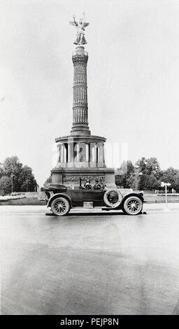 Germany Berlin The Victory Column is a monument in Berlin, Germany. Designed by Heinrich Strack, after 1864 to commemorate the Prussian victory in the Danish-Prussian War  A Pierce Arrow car in front of monument taken 1928  1920s - Stock Image