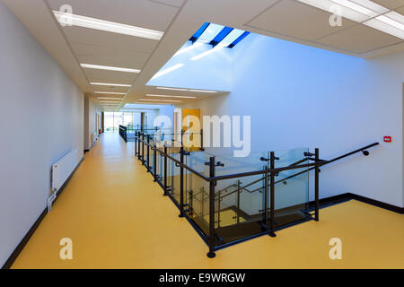 School corridor with stairs down and atrium roof lights - Stock Image