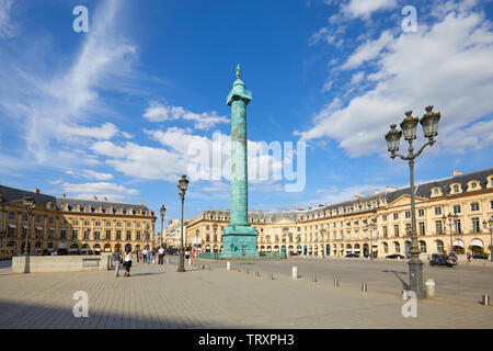 PARIS, FRANCE - JULY 21, 2017: Place Vendome with people and tourists in a sunny summer day, blue sky in Paris, France. - Stock Image