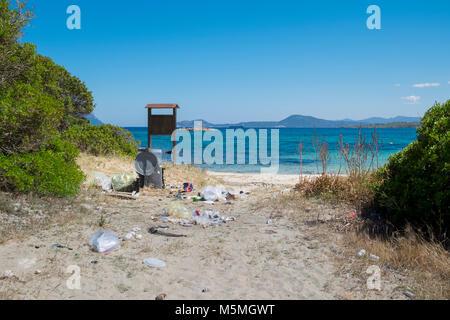 Litter and trash left on beach near Olbia, Sardinia, Italy - Stock Image