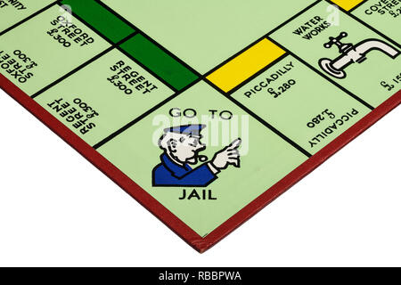 Close up detail of a corner of the playing board for the game of Monopoly showing Go To Jail - Stock Image