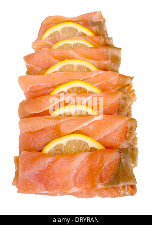 Smoked salmon sliced and arranged with lemon slices isolated against a white background - Stock Image