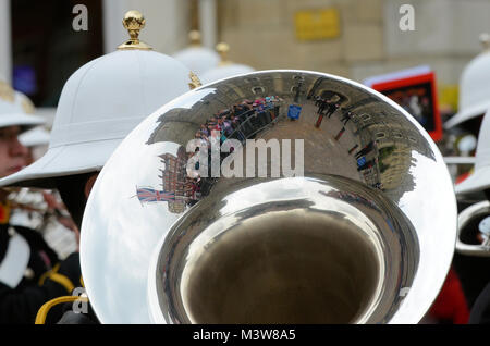 Windsor Castle and people reflected in a brass instrument of a Royal Marines marching band musician celebrating - Stock Image