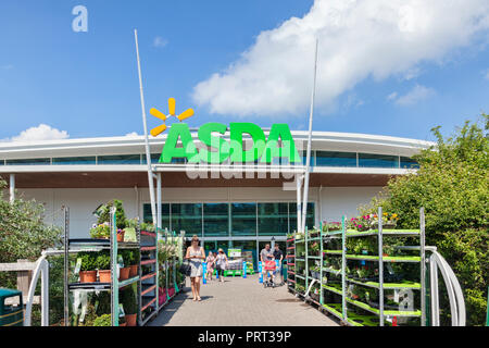 28 May 2018: Newton Abbot, Devon, UK - Asda supermarket entrance, with people leaving with their shopping. - Stock Image