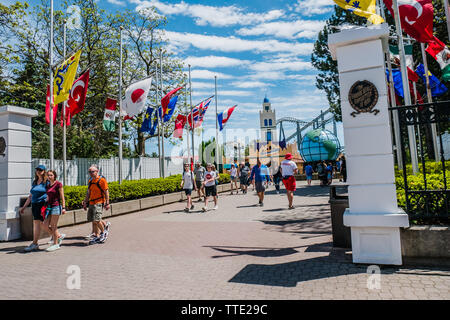 flags of different countries flying inside canada's wondeland, the largest amusement park in canada - Stock Image
