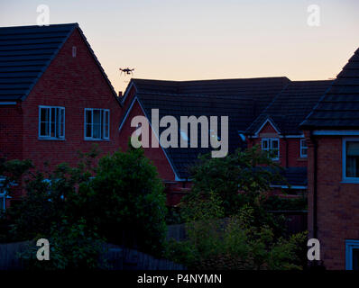 Derbyshire, UK. 22nd June 2018. Drone being flown dangerously close to a property on a built-up housing estate in Ashbourne, Derbyshire therefore not complying to The Drone Code Credit: Doug Blane/Alamy Live News - Stock Image