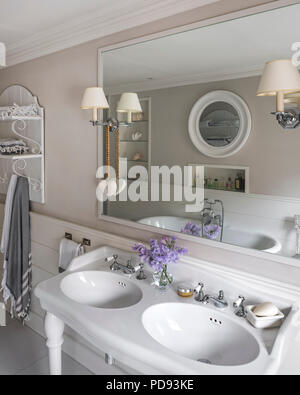 French Style Basins And A Free Standing Bath In Master Bathroom The Wall Lights Are From Vaughan Stock Photo Alamy