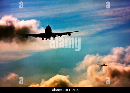 Wake turbulence forms behind aircrafts as they passes through the clouds when descending for landing. - Stock Image
