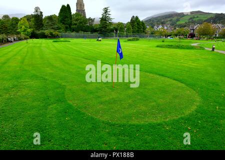 Freshly cut grass on a Putting Green with blue flag, Ambleside,Lake District,Cumbria,England,UK - Stock Image