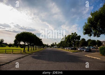 Very large asphalt road with big parking nearby - Stock Image