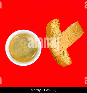 Cup of Strong Italian Espresso Coffee With Biscotti Biscuits Looking Down - Stock Image