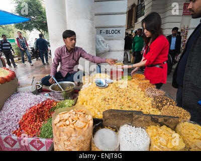 A street seller offering Bhelpuri in Connaught Place in Delhi India - Stock Image