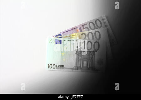 Euro banknotes disappearing into black, dirty earnings concept, copy space - Stock Image