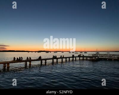Pier and sunset near Terrace at Memorial Union, Lake Mendota, University of Wisconsin, Madison, Wisconsin - Stock Image