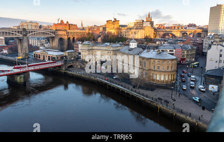 Newcastle, England, UK - February 5, 2019: Traffic  and trains move through the historic Quayside area of central Newcastle during the morning rush ho - Stock Image