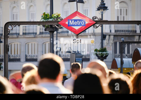 People walking and commuting near metro station of Sol in Madrid Spain - Stock Image