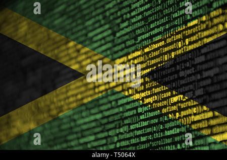 Jamaica flag  is depicted on the screen with the program code. The concept of modern technology and site development. - Stock Image