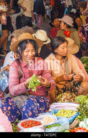 Siem Reap, Cambodia - 14th January 2018: Women selling vegetables in the Old Market. The market is open every day for local produce. - Stock Image