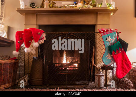 Christmas Eve and a fireplace set for Santa Claus - Stock Image