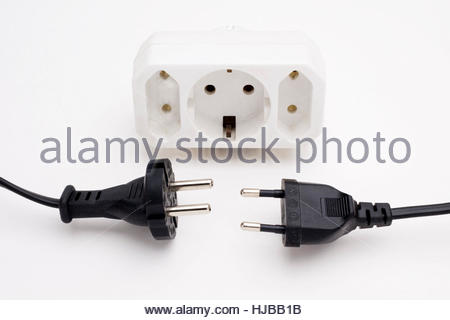 Two different types of European plugs — Type F (4.8mm pins) on left and Type C (4mm pins) on right — with corresponding - Stock Image