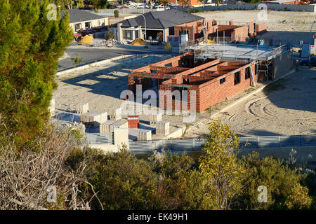 New houses being built on the edge of bushland in the suburbs of Perth, Western Australia. - Stock Image
