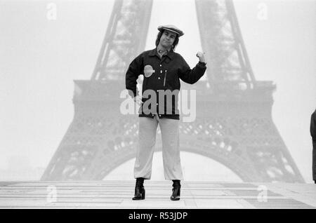 Elton John pictured in Paris in front of the Eiffel Tower. His visit to Paris was to play a concert. 21st February 1979.Elton John pictured in Paris in front of the Eiffel Tower. His visit to Paris was to play a concert. 21st February 1979. - Stock Image