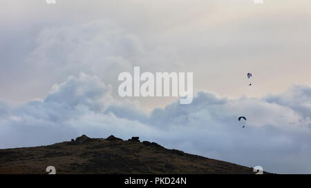 Two paragliders over Honeybags tor in Dartmoor National Park in Devon - Stock Image