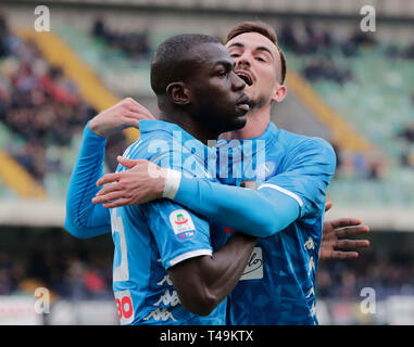 Verona, Italy. 14th Apr, 2019. Stadio Marcantonio Bentegodi, Verona, Italy. 14th Apr, 2019. Serie A football, Chievo versus Napoli; Kalidou Koulibaly of Napoli celebrates with Fabian Ruiz of Napoli after scores 1 - 0 in the 16th minute Credit: Action Plus Sports Images/Alamy Live News - Stock Image