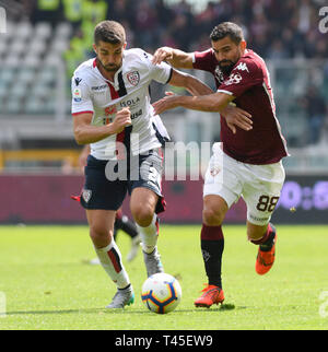 Turin, Italy. 14th Apr, 2019.  Serie A football, Torino versus Cagliari; Paolo Farago of Cagliari challenges Tomas Rincon of Torino FC Credit: Action Plus Sports Images/Alamy Live News - Stock Image