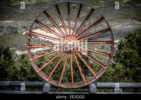 Cast -iron machine wheel at Bendigo gold mine in the Knysna Forest, part of the Garden Route National Park, South - Stock Image