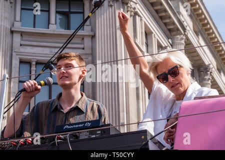 London, UK. 19th April 2019. Dame Emma Thompson raises her fist aftger speaking at Extinction Rebellion's Sea of Protest in Oxford Circus around large pink yacht, names after the Honduran environmental activist Berta Cáceres, assassinated in 2016. She came as a part of the activities to show 'Love For The Earth' on the 5th day of the occupation, but which were interrupted by police shortly after she spoke. Credit: Peter Marshall/Alamy Live News - Stock Image