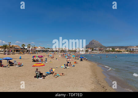 Xabia Spain Playa del Arenal beach in summer with blue sky and people sunbathing - Stock Image