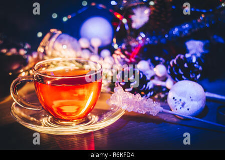 Cup of tea and winter decorative objects in beautiful blue light. Magic Christmas - Stock Image