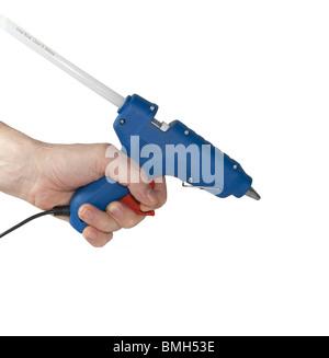 Glue pistol in hand - Stock Image