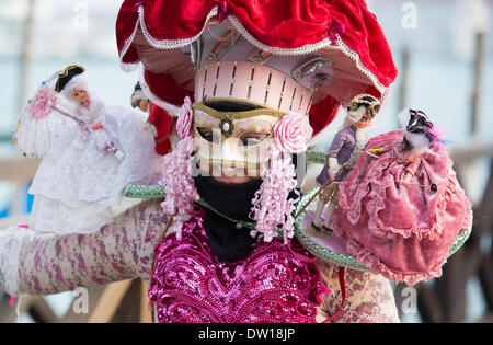 Venice, Italy. 25th Feb, 2014. This costume features shoulder pads supporting dolls also in Carnivale dress. Venice Carnivale - Tuesday 25th February. Credit:  MeonStock/Alamy Live News - Stock Image