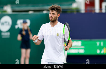 Eastbourne, UK. 25th June, 2019. Juan Ignacio Lóndero of Argentina in action against Jay Clarke of Great Britain during their match at the Nature Valley International tennis tournament held at Devonshire Park in Eastbourne . Credit: Simon Dack/Alamy Live News - Stock Image