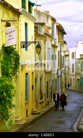 Arles; Bouches du Rhone, France; A couple walking through a typical street in town - Stock Image