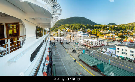 Sept 17, 2018 - Ketchikan, AK: Elevated view, cruise ship docks, from The Volendam at sunset with emptying Front Street and Visitors Buroeau building - Stock Image