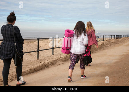 Crosby, Merseyside. 20th March, 2019. Family group heading for the beach on a warm hazy spring day at the coast. Credit: MWI/AlamyLiveNews - Stock Image
